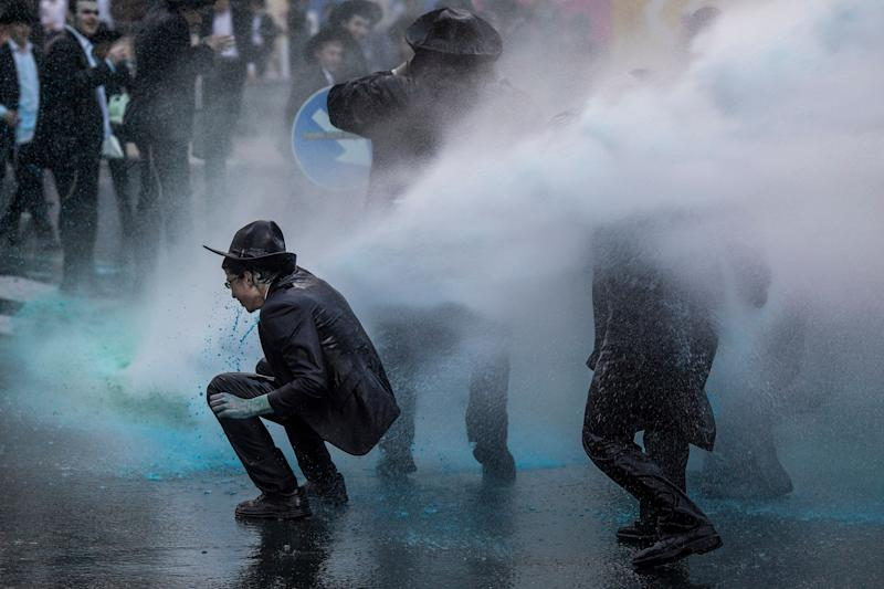 March 7, 2019 - Jerusalem, Israel - Israeli policemen use water cannons to disperse Ultra-Orthodox Jewish protesters during a demonstration against Israeli army conscription. (Credit Image: Ilia Yefimovich/DPA via ZUMA Press)