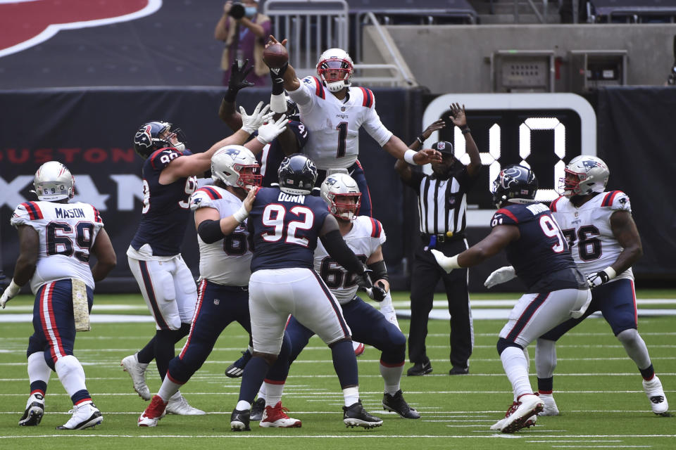 New England Patriots quarterback Cam Newton (1) bats down the ball after his pass was deflected during the second half of an NFL football game against the Houston Texans, Sunday, Nov. 22, 2020, in Houston. (AP Photo/Eric Christian Smith)