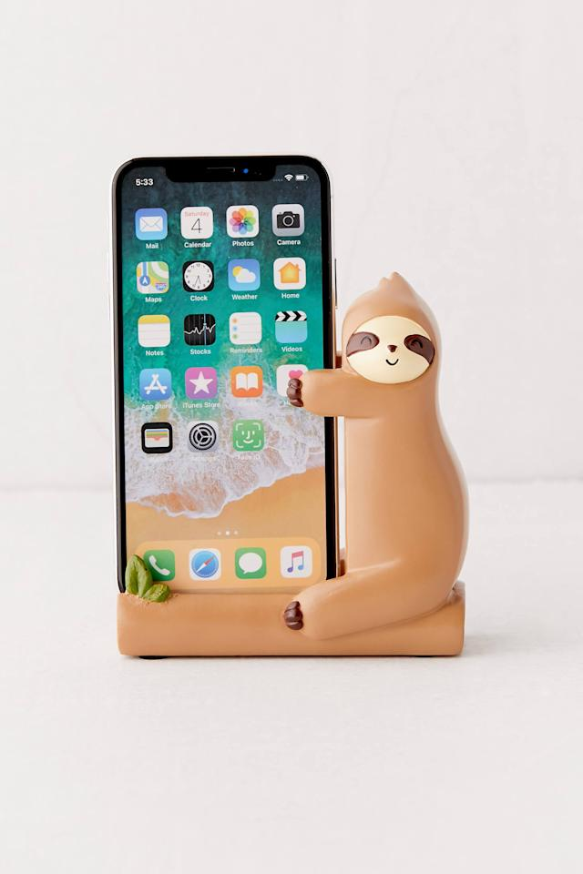 "<p>They need this <a href=""https://www.popsugar.com/buy/Sloth-Phone-Holder-518694?p_name=Sloth%20Phone%20Holder&retailer=urbanoutfitters.com&pid=518694&price=18&evar1=savvy%3Aus&evar9=45416002&evar98=https%3A%2F%2Fwww.popsugar.com%2Fsmart-living%2Fphoto-gallery%2F45416002%2Fimage%2F46908085%2FSloth-Phone-Holder&list1=shopping%2Cgifts%2Choliday%2Cstocking%20stuffers%2Cgift%20guide%2Cgifts%20for%20women%2Cgifts%20for%20men%2Cgifts%20under%20%24100&prop13=api&pdata=1"" rel=""nofollow"" data-shoppable-link=""1"" target=""_blank"" class=""ga-track"" data-ga-category=""Related"" data-ga-label=""https://www.urbanoutfitters.com/shop/sloth-phone-holder?category=SEARCHRESULTS&amp;color=020"" data-ga-action=""In-Line Links"">Sloth Phone Holder</a> ($18) for their desk.</p>"