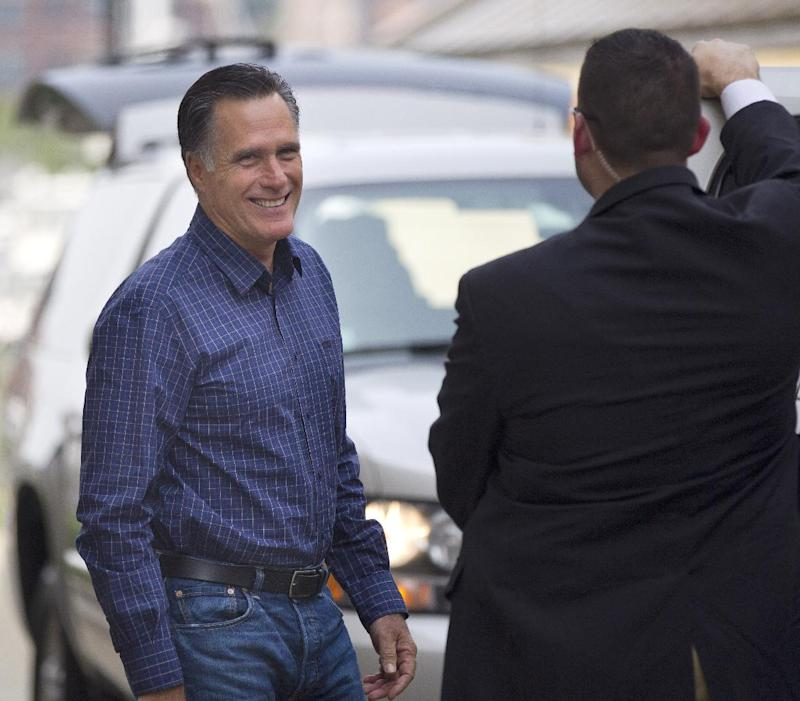 Republican presidential candidate, former Massachusetts Gov. Mitt Romney leaves his headquarters in Boston, Friday, Aug. 17, 2012.  (AP Photo/Evan Vucci)