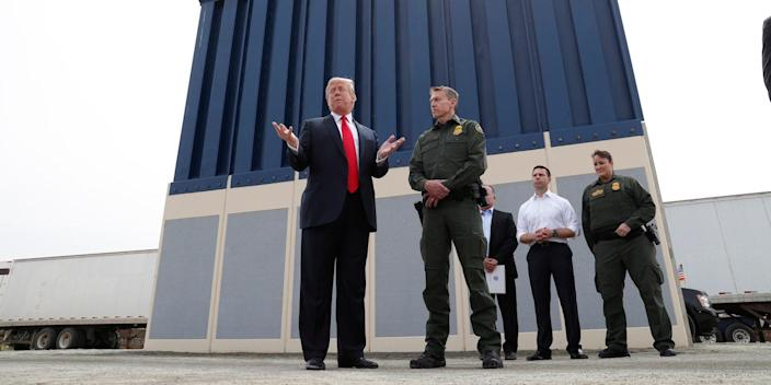 Trump with prototypes of the border wall.