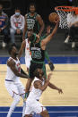 Boston Celtics guard Romeo Langford (45) drives to the basket against New York Knicks forward Julius Randle (30) during the first half of an NBA basketball game in New York, Sunday, May 16, 2021. (Vincent Carchietta/Pool Photo via AP)