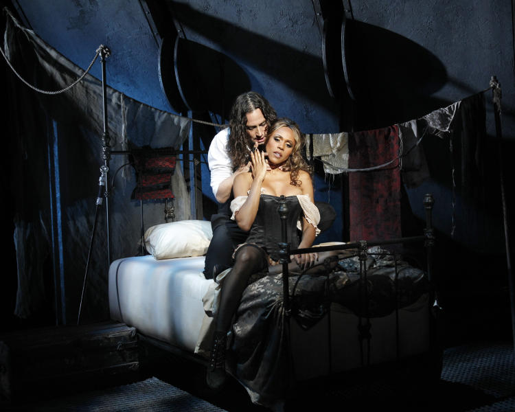 "This theater publicity image released by The Hartman Group shows Constantine Maroulis, left, and Deborah Cox during a performance of ""Jekyll & Hyde"" playing at the Marquis Theatre in New York. (AP Photo/The Hartman Group, Chris Bennion)"