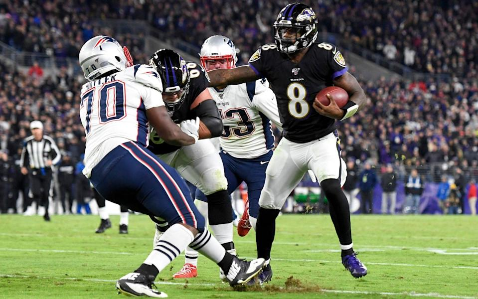 Lamar Jackson rushed for two touchdowns as the Ravens handed the Patriots their first loss - USA TODAY Sports