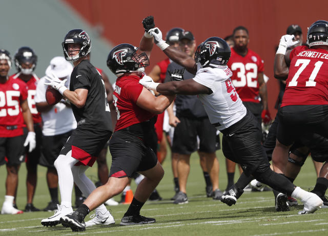 Atlanta Falcons first-round draft pick offensive guard Chris Lindstrom (63) blocks defensive tackle Grady Jarrett (97), right, as quarterback Matt Ryan throws a pass during their NFL training camp football practice Monday, July 22, 2019, in Flowery Branch, Ga.(AP Photo/John Bazemore)