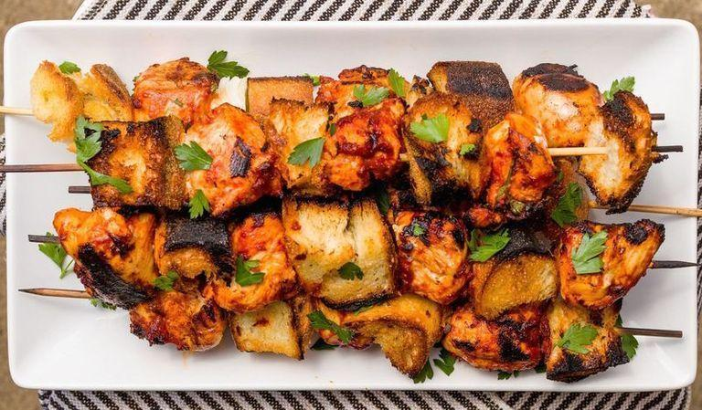 """<p>Marinate the chicken in a quick savoury mixture of tomato paste, olive oil, lots of garlic, and fresh parsley for the perfect accompaniment to grilled bread.</p><p>Get the <a href=""""https://www.delish.com/uk/cooking/recipes/a30013363/italian-chicken-skewers-recipe/"""" rel=""""nofollow noopener"""" target=""""_blank"""" data-ylk=""""slk:Italian Chicken Skewers"""" class=""""link rapid-noclick-resp"""">Italian Chicken Skewers</a> recipe.</p>"""