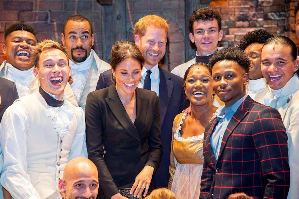 """Prince Harry and Meghan Markle with the cast of """"Hamilton"""" in August 2018."""