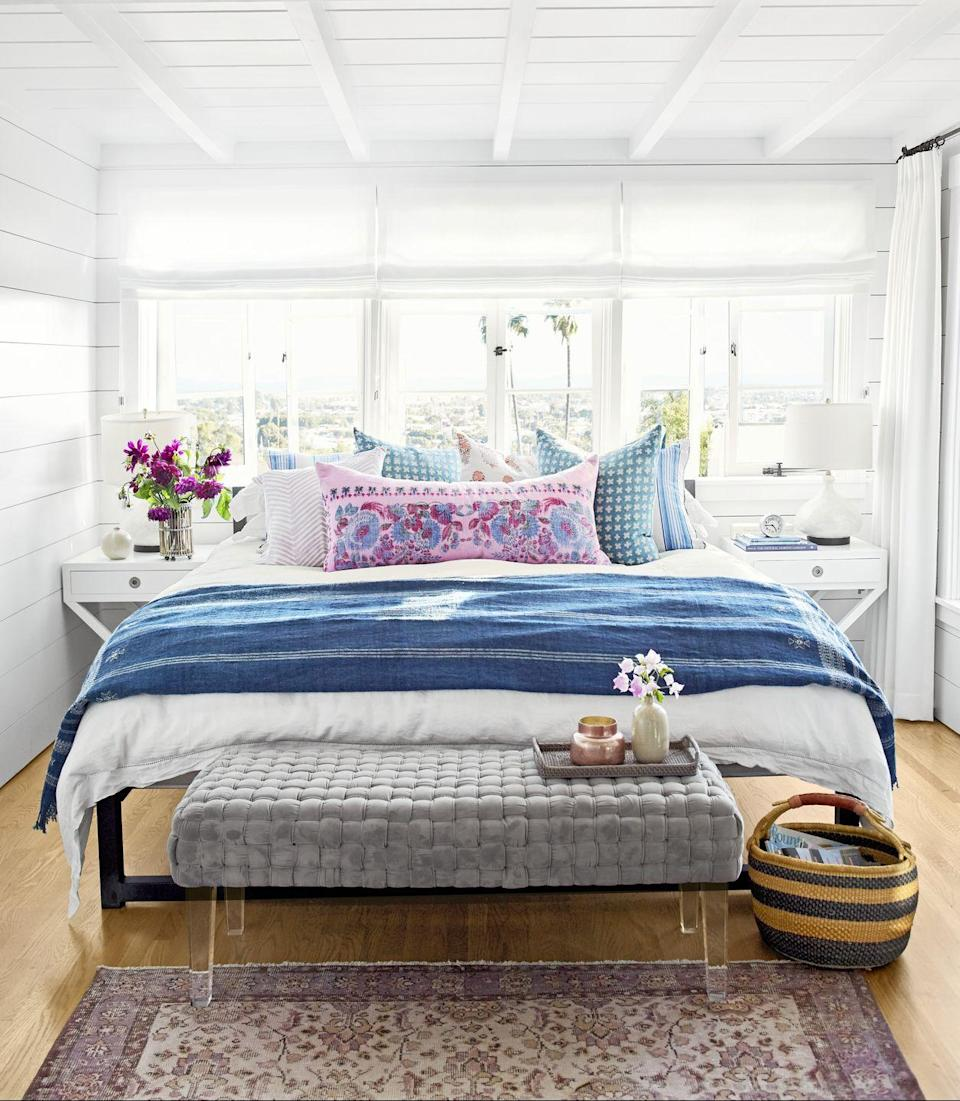 <p>Short on space? Put accent seating at the foot of your bed. It offers a serene spot to read or relax.</p>