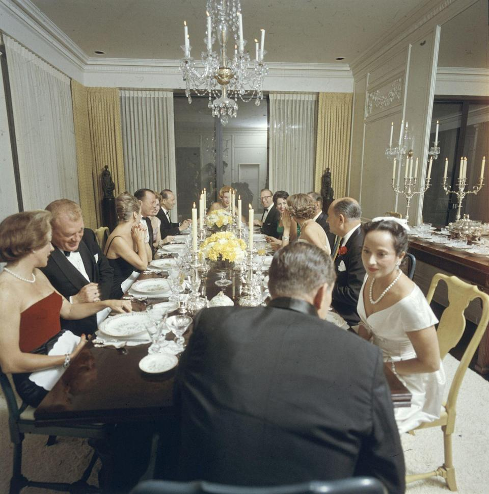 """<p>Parties were not just a way to socialize, but a way to fulfill obligations to acquaintances or colleagues. Guest lists were carefully combed over to include the most interesting guests who would enjoy <em>each other, </em>according to <em><a href=""""https://www.amazon.com/Calvert-Party-Encyclopedia-Complete-Entertaining/dp/B00ERBG68S?tag=syn-yahoo-20&ascsubtag=%5Bartid%7C10063.g.35750030%5Bsrc%7Cyahoo-us"""" rel=""""nofollow noopener"""" target=""""_blank"""" data-ylk=""""slk:The"""" class=""""link rapid-noclick-resp"""">The </a></em><em><a href=""""https://www.amazon.com/Calvert-Party-Encyclopedia-Complete-Entertaining/dp/B00ERBG68S?tag=syn-yahoo-20&ascsubtag=%5Bartid%7C10063.g.35750030%5Bsrc%7Cyahoo-us"""" rel=""""nofollow noopener"""" target=""""_blank"""" data-ylk=""""slk:Calvert Party Encyclopedia"""" class=""""link rapid-noclick-resp"""">Calvert Party Encyclopedia</a>:</em> """"... blend a group which will enjoy each other's company and make for a pleasurable evening.""""</p>"""