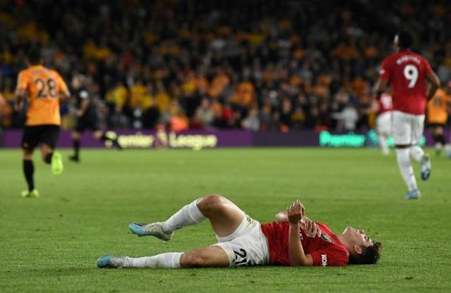 Manchester United's Daniel James didn't win any friends when he was booked for diving in a failed attempt to win a free-kick from referee Jon Moss (AFP Photo/Paul ELLIS )