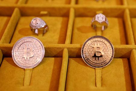 Jewelry with the Bitcoin logo is seen on display at the Consensus 2018 blockchain technology conference in New York City, New York, U.S., May 16, 2018. REUTERS/Mike Segar