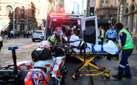 A woman is taken to hospital from Hotel CBD in Sydney - Credit: AAP Image