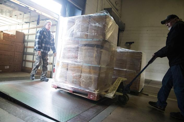 Nearly 500,000 disposable face masks are unloaded at D&S Wharehousing Inc Tuesday morning in Newark. The masks are assumed to be heading to COVID-19 hotspots across the United States and possible local hospitals in Delaware.