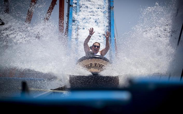 A woman rides the Wild River ride at the Orange County Fair.