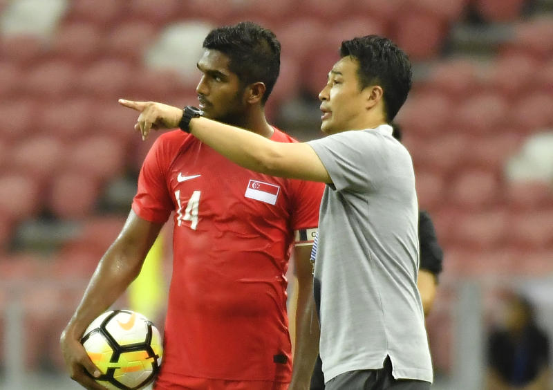 Singapore national football team coach Tatsuma Yoshida with captain Hariss Harun. (PHOTO: PictoBank/Getty Images)