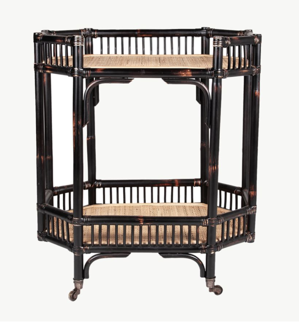 """<p>potterybarn.com</p><p><strong>$629.00</strong></p><p><a href=""""https://go.redirectingat.com?id=74968X1596630&url=https%3A%2F%2Fwww.potterybarn.com%2Fproducts%2Fkelona-rattan-bar-cart-mp&sref=https%3A%2F%2Fwww.veranda.com%2Fluxury-lifestyle%2Fg36523869%2Frattan-furniture%2F"""" rel=""""nofollow noopener"""" target=""""_blank"""" data-ylk=""""slk:Shop Now"""" class=""""link rapid-noclick-resp"""">Shop Now</a></p><p><a href=""""https://www.potterybarn.com/"""" rel=""""nofollow noopener"""" target=""""_blank"""" data-ylk=""""slk:Pottery Barn's"""" class=""""link rapid-noclick-resp"""">Pottery Barn's</a> rattan cart will add a touch of 1960s island glamour to any bar or living room. It would also look great as storage in a bathroom or as a plant stand.<br></p>"""