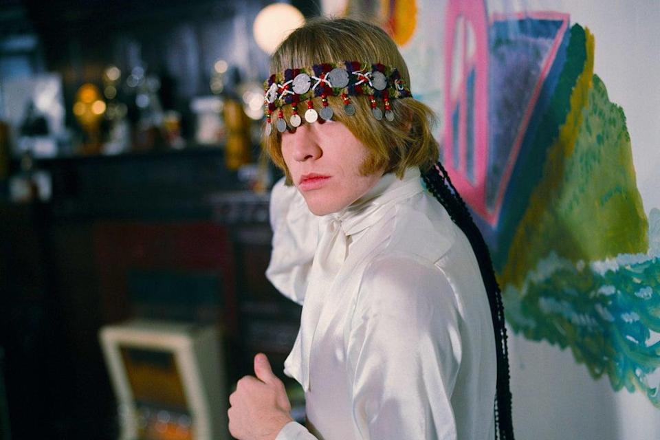 <p>Brian Jones at home with north African headress. Courtfield Gardens, South Kensington</p> (Gered Mankowitz)