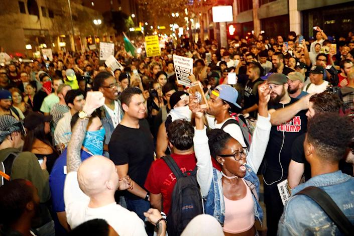 <p>Demonstrators march in protest through the streets of downtown Los Angeles following the election of Republican Donald Trump as President of the United States in Los Angeles, Calif., on Nov. 10, 2016. (Photo: Patrick T. Fallon/Reuters) </p>