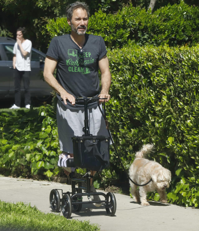 <p>An injured Eric McCormack uses a scooter to take his dog out on Monday in L.A. </p>