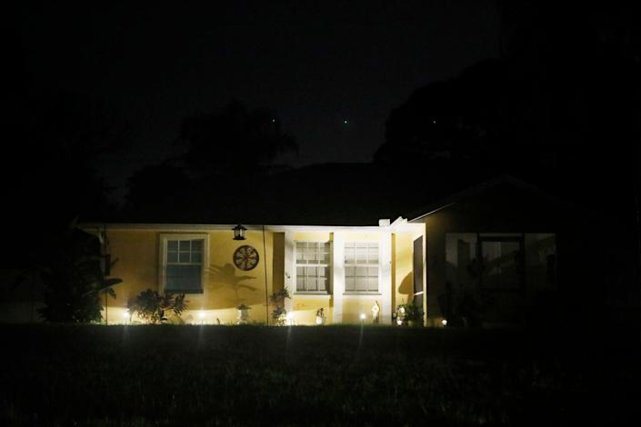 The Laundrie family home is pictured at night as officers continue their search (Getty )