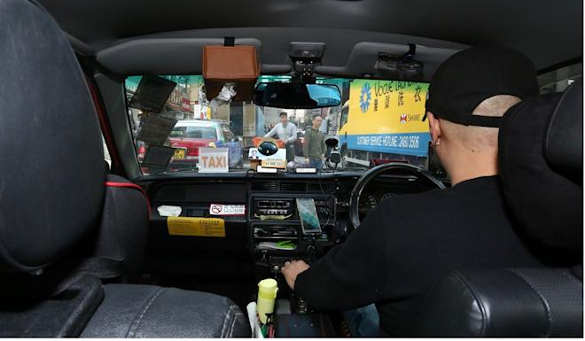 As well as driving a taxi, Bill Wong is a 'garage manager' for Uber Flash. Photo: Jonathan Wong