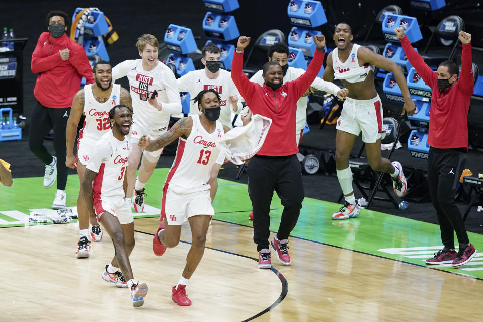 Houston players celebrate after beating Rutgers in a college basketball game in the second round of the NCAA tournament at Lucas Oil Stadium in Indianapolis Sunday, March 21, 2021. Houston won 63-60. (AP Photo/Mark Humphrey)