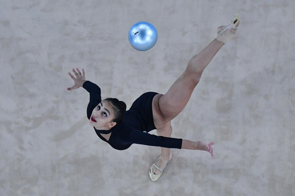 <p>Azerbaijan's Zohra Aghamirova competes in the individual all-around qualification of the Rhythmic Gymnastics event during Tokyo 2020 Olympic Games at Ariake Gymnastics centre in Tokyo, on August 6, 2021. (Photo by Antonin THUILLIER / AFP)</p>