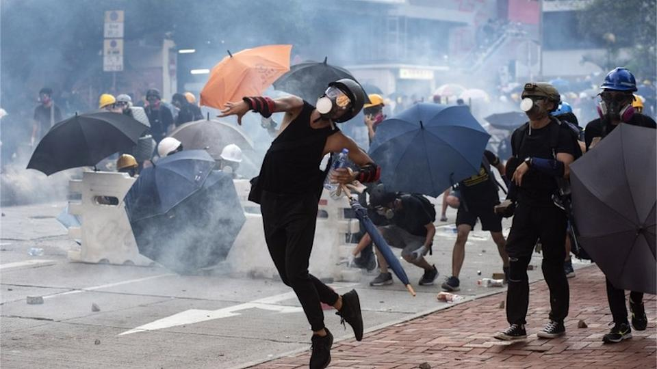 Protesters throwing bricks