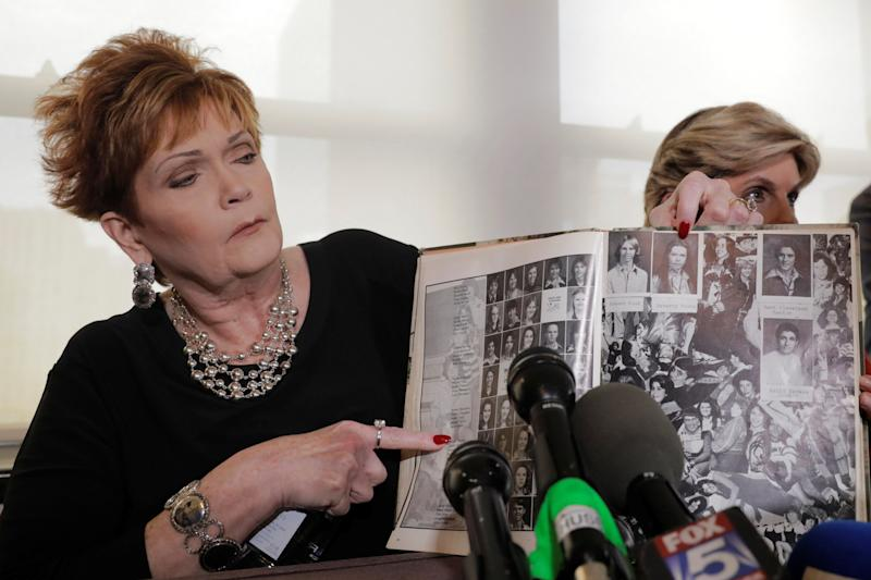 Beverly Young Nelson points to a photograph of herself in her high school yearbook after claiming that Moore sexually harassed her when she was 16. She made the allegation at a press conference in New York on Nov. 13.