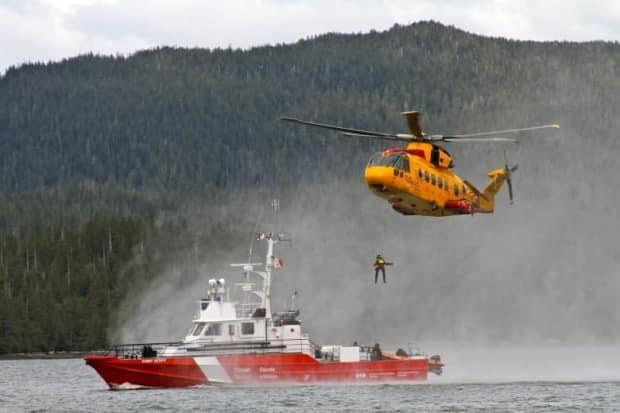 A CH-149 Cormorant takes part in a training exercise with CCGS Point Henry. ( - image credit)