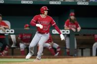 Los Angeles Angels' Shohei Ohtani rounds third after stealing second and advancing on a Texas Rangers throwing error in the sixth inning of a baseball game in Arlington, Texas, Wednesday, Sept. 29, 2021. (AP Photo/Tony Gutierrez)