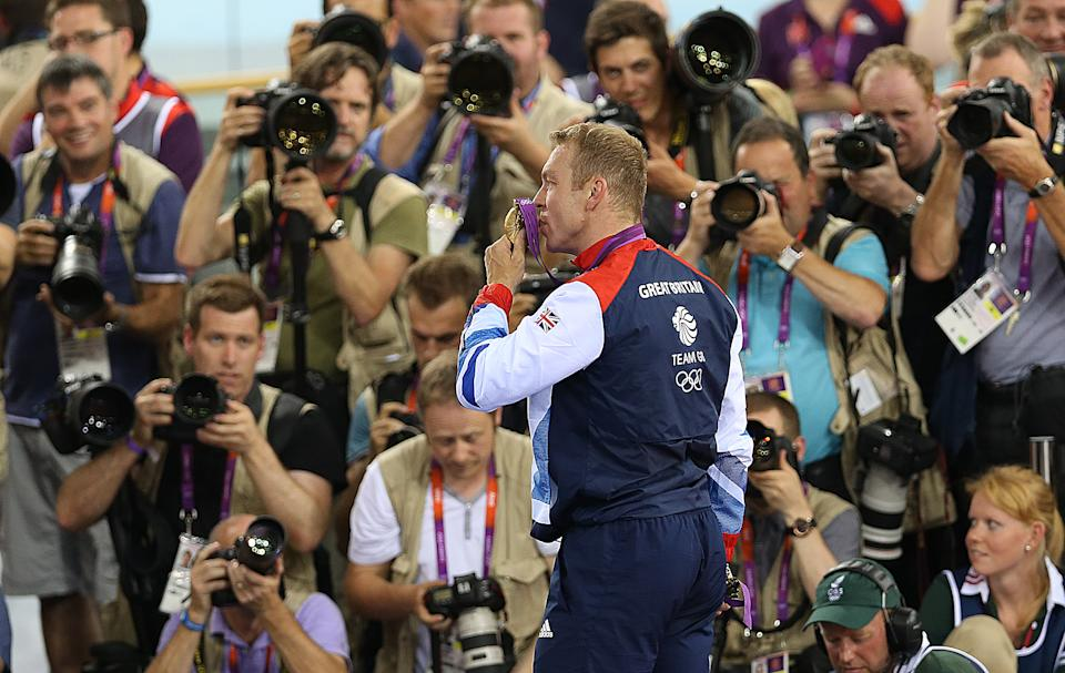LONDON, ENGLAND - AUGUST 07: Sir Chris Hoy of Great Britain celebrates on the podium after winning the gold medal in final of the men's Keirin during Day 11 of the London 2012 London Olympics at the Veledrome on August 07, 2012 in London, England. (Photo by Ian MacNicol/Getty Images)