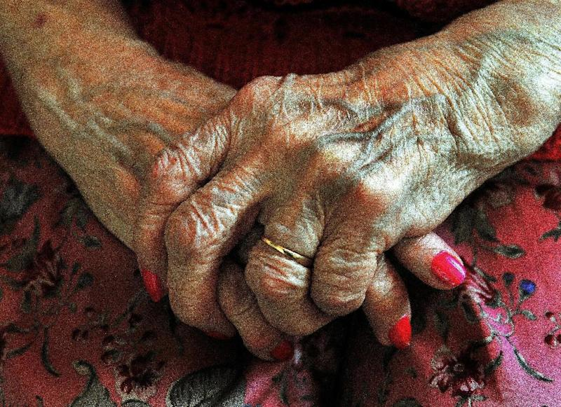 File photo dated 05/12/08 of the hands of an elderly woman as around two million elderly women are missing out on the benefits of being online, a charity has warned. More must be done to help older people to get access to the internet, Age UK said.