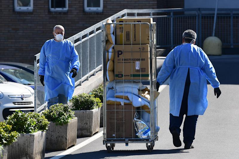 A worker pushes a cart at the hospital in Codogno, southeast of Milan, on March 11, 2020 a day after Italy imposed unprecedented national restrictions on its 60 million people Tuesday to control the deadly COVID-19 coronavirus. (Photo by Miguel MEDINA / AFP) (Photo by MIGUEL MEDINA/AFP via Getty Images)