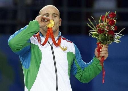 Artur Taymazov of Uzbekistan poses with his gold medal in the 120kg men's freestyle wrestling at the Beijing 2008 Olympic Games