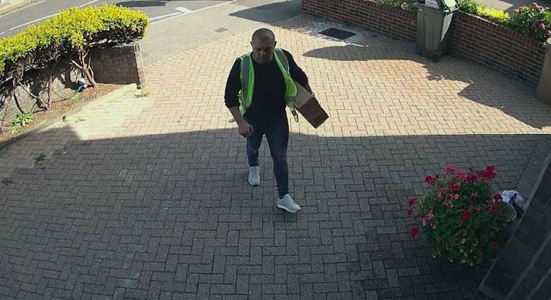 Sandel Hornea was carrying a parcel and wearing a high-vis jacket when he stormed the property. (SWNS)