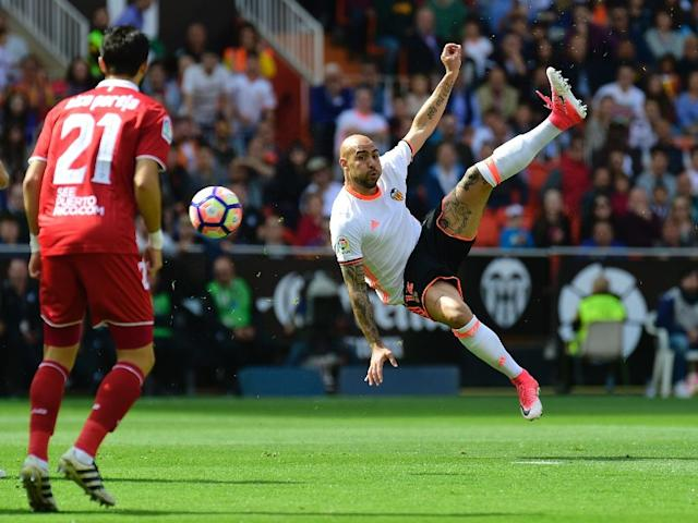 Valencia's forward Simone Zaza jumps to kick the ball during the Spanish league football match Valencia CF vs Sevilla FC at the Mestalla stadium in Valencia on April 16, 2017 (AFP Photo/JOSE JORDAN)