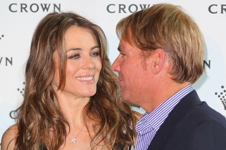 MELBOURNE, AUSTRALIA - NOVEMBER 12:  Shane Warne and Elizabeth Hurley pose as they attend the launch of the Shane Warne Foundation's Ambassador Program at Club 23 on November 12, 2013 in Melbourne, Australia.  (Photo by Scott Barbour/Getty Images)