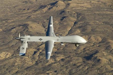 A U.S. Air Force MQ-1 Predator unmanned aerial vehicle flies near the Southern California Logistics Airport in Victorville, California in this USAF handout photo