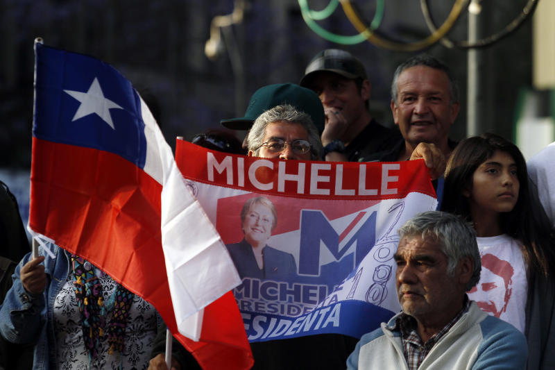Supporters of Chile's former President Michelle Bachelet stand together after hearing partial election results in Santiago, Chile, Sunday, Nov. 17, 2013. Bachelet is ahead as votes are being counted in Chile's presidential election, but she is running short of the majority needed to avoid a Dec. 15 runoff. (AP Photo/Luis Hidalgo)
