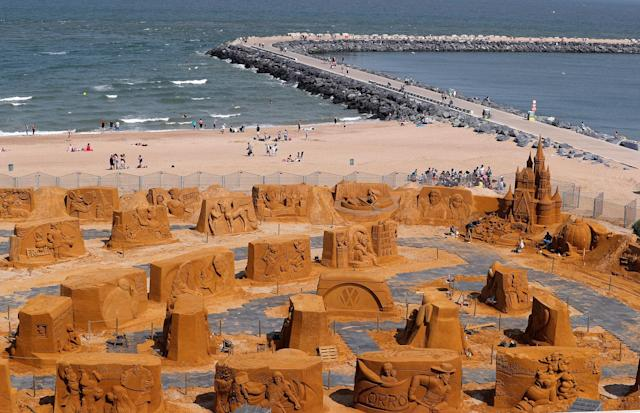 "<p>Sand sculptures are seen during the Sand Sculpture Festival ""Disney Sand Magic"" in Ostend, Belgium June 22, 2017. A team of 32 carvers from around the world spent five weeks building 150 sculptures based on Disney, Pixar, Star Wars and Marvel movies. Seven thousand tonnes of sand brought by 240 trucks were needed to make the sculptures which will be on show between June 24 to September 10. (Yves Herman/Reuters) </p>"
