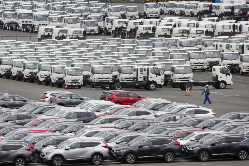In this July 8, 2019, photo, cars wait to be exported at Yokohama port, near Tokyo. Japan had the second straight year of red ink in trade for year 2019, hurt by a slowdown of demand in China, according to government data released Thursday, Jan. 23, 2020. (AP Photo/Koji Sasahara)