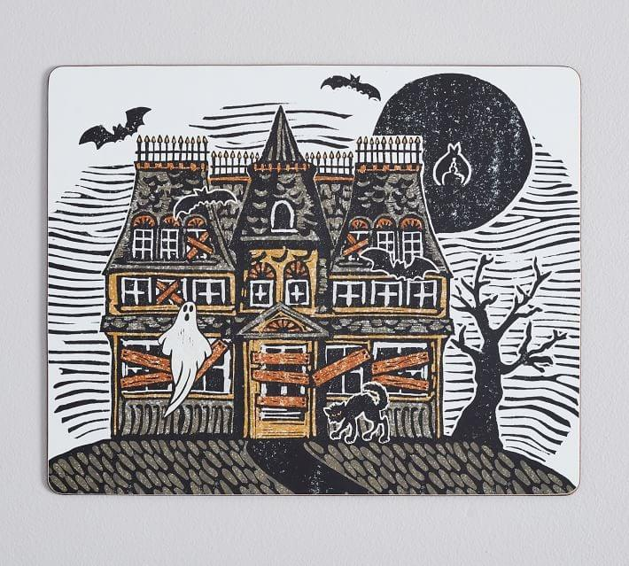 <p>Transform your home into a haunted house with these <span>Haunted House Cork Placemats </span> ($48).</p>