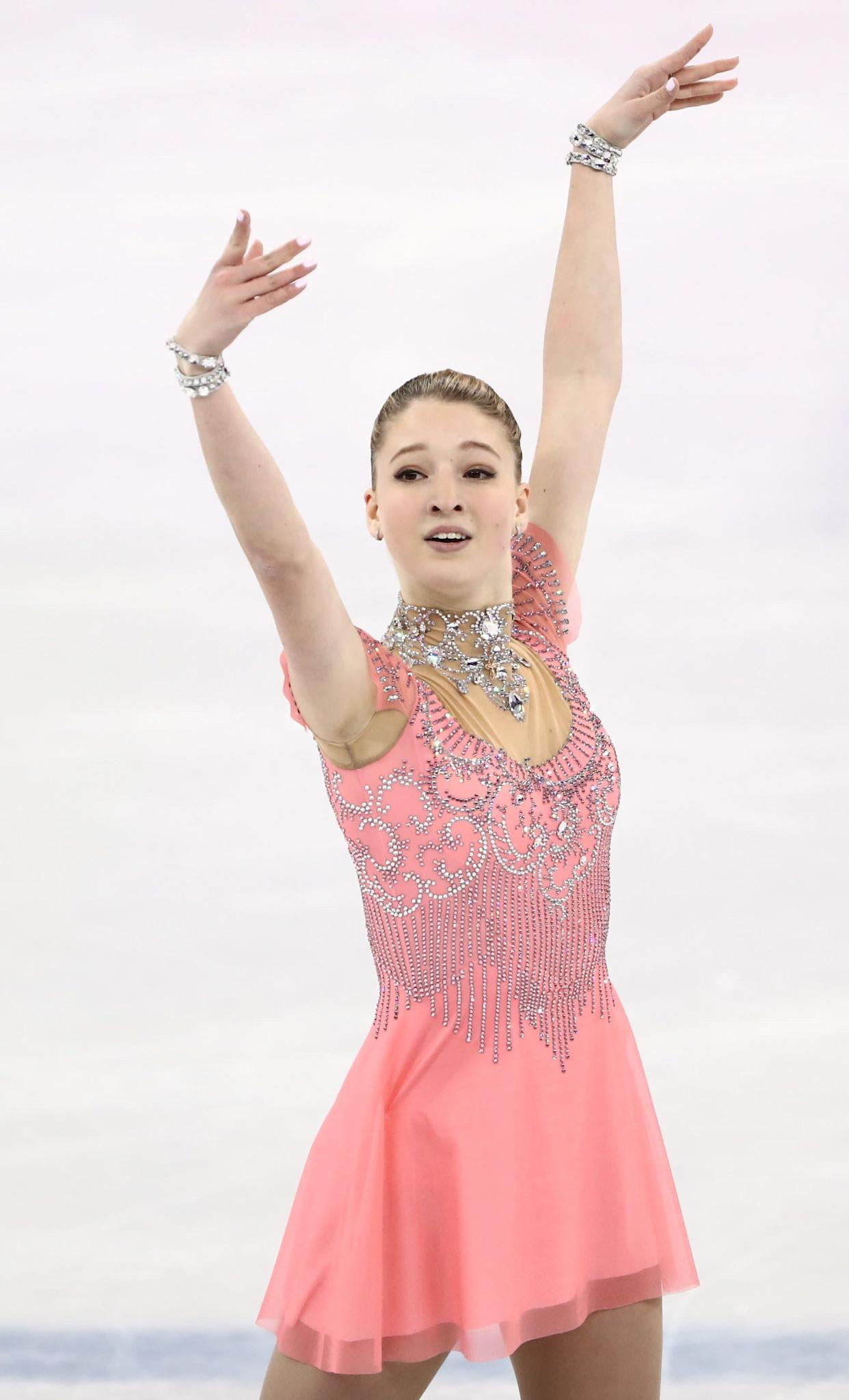 The skater from Russia was pretty in pink for her ladies short program. It's the embellished neckline and cuffs that really make this costume pop, though.