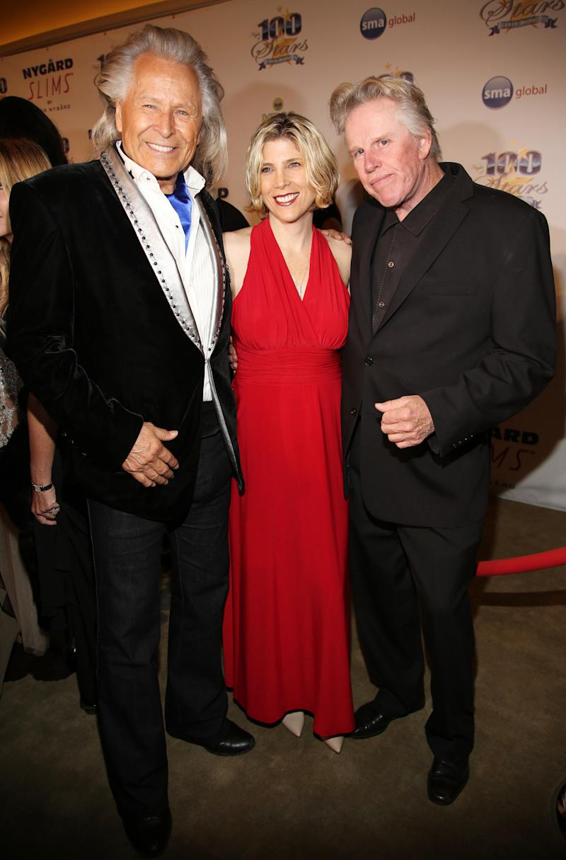 Peter Nygard, from left, Steffanie Busey, and Gary Busey arrive at the 24th Night of 100 Stars Oscars Viewing Gala at The Beverly Hills Hotel on Sunday, March 2, 2014 in Beverly Hills, Calif. (Photo by Annie I. Bang /Invision/AP)