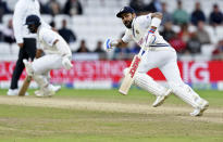 India's captain Virat Kohli, right, runs between the wickets to score during the third day of third test cricket match between England and India, at Headingley cricket ground in Leeds, England, Friday, Aug. 27, 2021. (AP Photo/Jon Super)