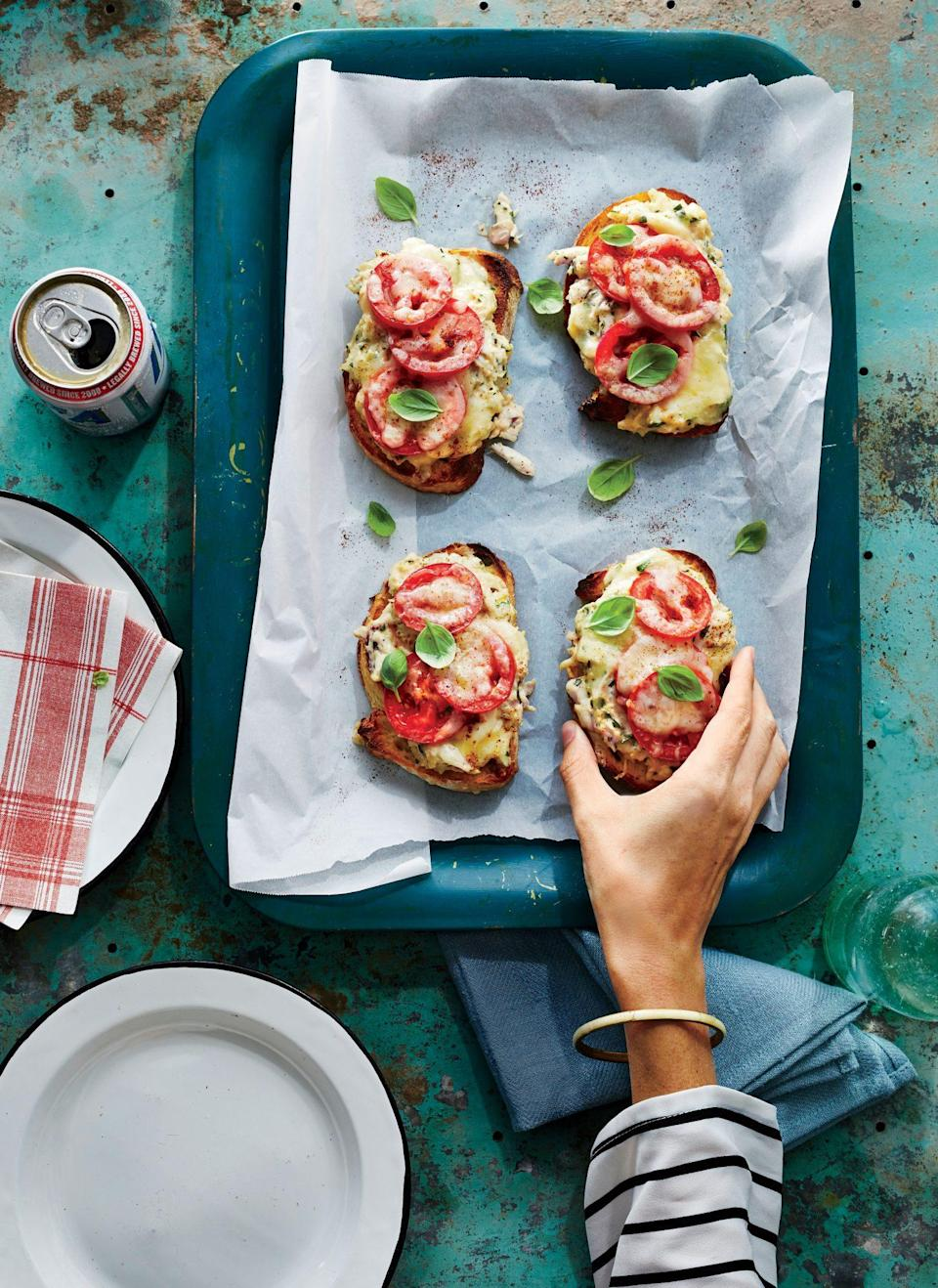 """<p><strong>Recipe:</strong> <a href=""""https://www.southernliving.com/recipes/deviled-crab-melts-recipe"""" rel=""""nofollow noopener"""" target=""""_blank"""" data-ylk=""""slk:Deviled Crab Melts"""" class=""""link rapid-noclick-resp"""">Deviled Crab Melts</a></p> <p>Who doesn't love an open-faced sandwich at brunch? Fresh tomatoes and gooey cheese make this the perfect summer bite.</p>"""