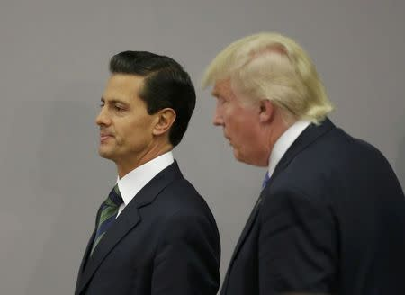 U.S. Republican presidential nominee Donald Trump and Mexico's President Enrique Pena Nieto walk out after finishing a press conference at the Los Pinos residence in Mexico City, Mexico, August 31, 2016. REUTERS/Henry Romero