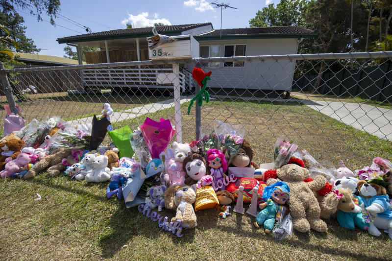 Tributes are seen at a house on Logan Reserve Road, Waterford West.