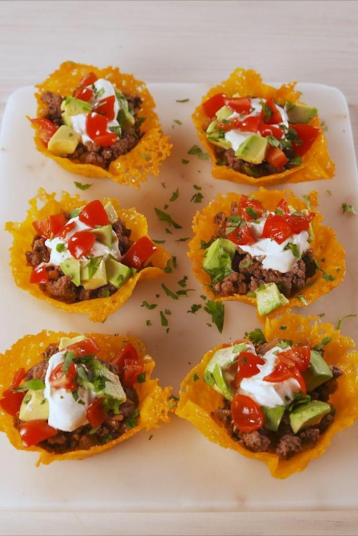 """<p>Cheese cups have more fun. </p><p>Get the recipe from <a href=""""https://www.delish.com/cooking/recipe-ideas/a19637783/keto-taco-cups-recipe/"""" rel=""""nofollow noopener"""" target=""""_blank"""" data-ylk=""""slk:Delish"""" class=""""link rapid-noclick-resp"""">Delish</a>. </p>"""